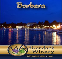 The Barbera label, featuring a gorgeous photograph of the glowing night lights of July 4th reflecting on Lake George.
